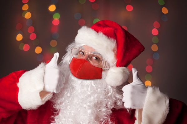 Santa Claus in Face Mask With Two Thumbs Up